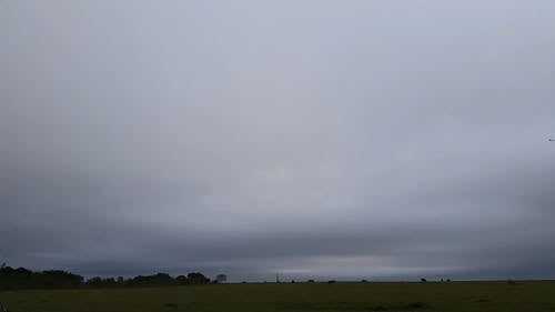 Time-Lapse Video of Pasture Land Under Cloudy Sky