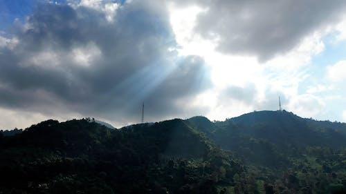 A Mountain Range Under Cloudy Sky