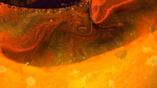 An Orange Liquid Paint in Motion