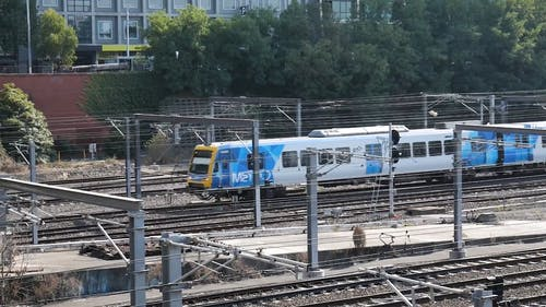A Train Moving in Railway Tracks