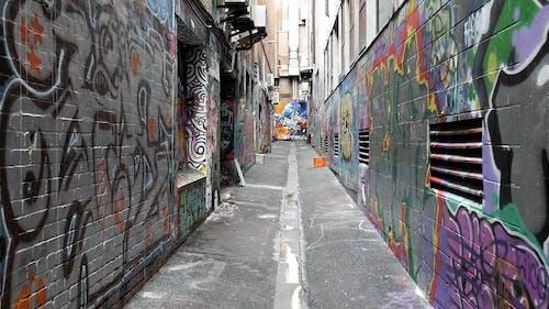 An Alleyway Full of Graffiti Art on Wall