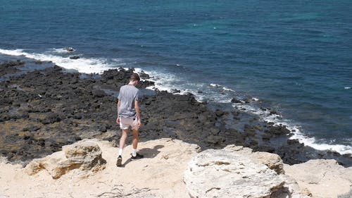 A Man Standing on Cliff Edge