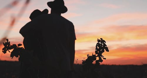 Silhouette of a Couple Hugging Each Other During Sunset