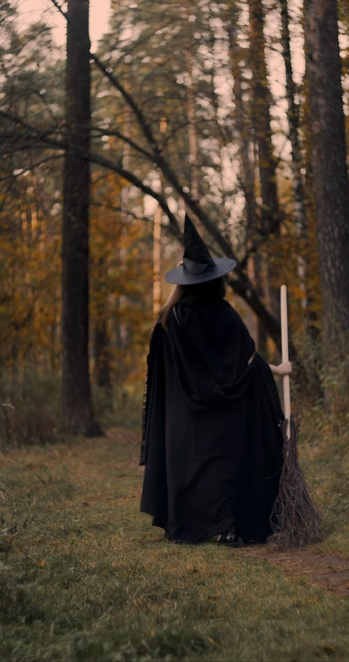 A Black Witch Walking In The Forest