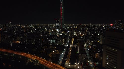 Iluminated Tower in a City at Night