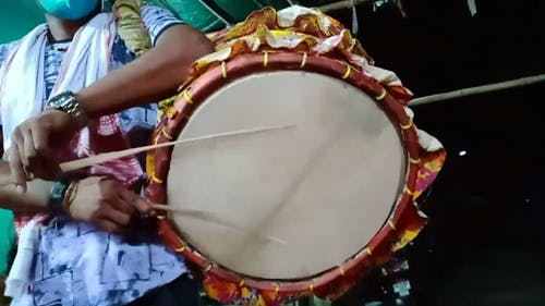 Person Playing a Drum