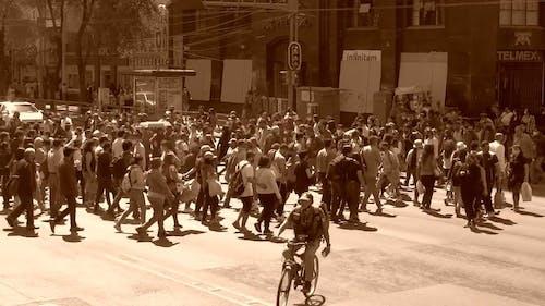Crowded Crosswalk in Sepia Tones