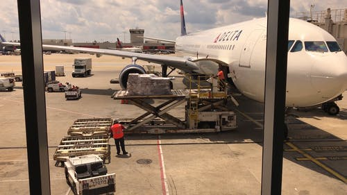People Unloading the Cargo on the Airplane