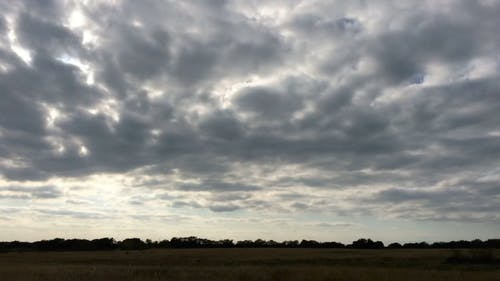 Timelapse Sunset in Cloudy Skies