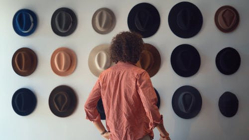 Person Looking at Hats