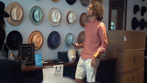 Man Choosing a Hat