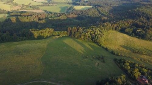 Aerial View of Green Fields and Medieval Castle Ruins