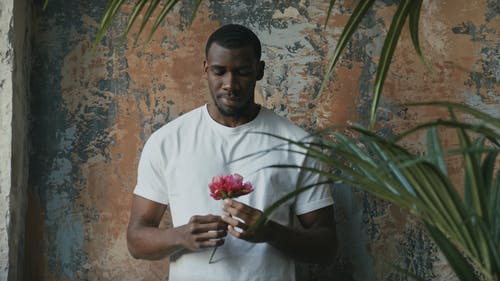 Young Man Holding Flower