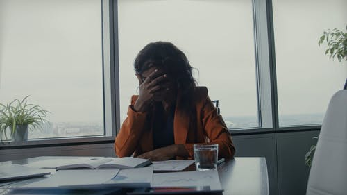 A Woman Feeling Fatigue By Overworking