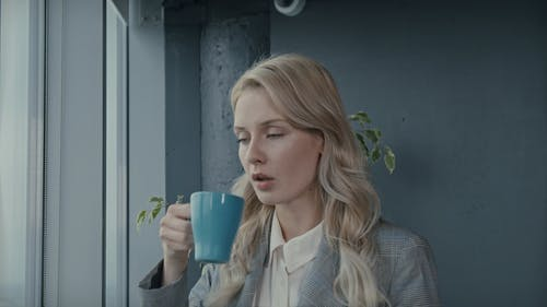 A Woman Having A Cup Of Coffee