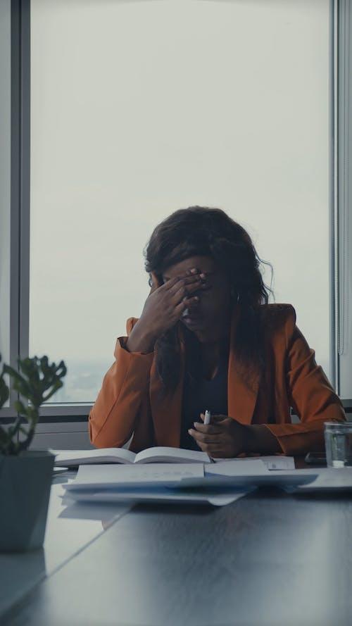 A Woman Feeling Fatigue While Working Hard