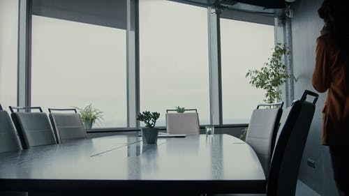 A Woman Working In The Conference Room