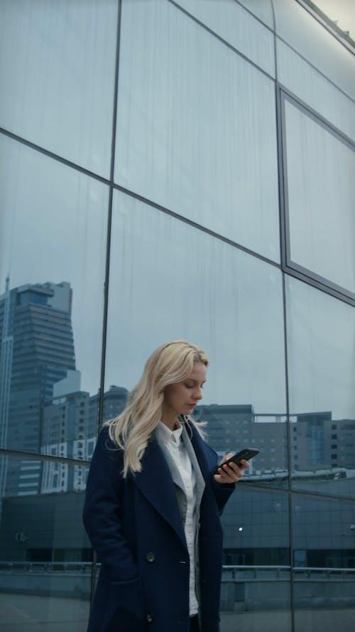A Woman Making A Phone Call Outside