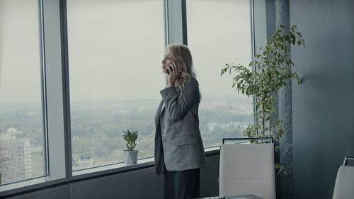 A Lady Boss Talking On Her Cellphone