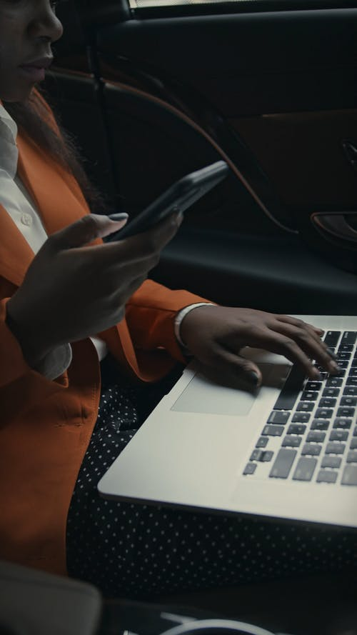 A Busy Woman Working While Inside The Car