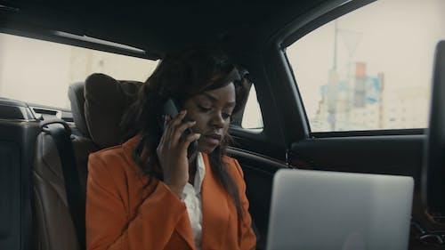 A Woman Working Inside A Car