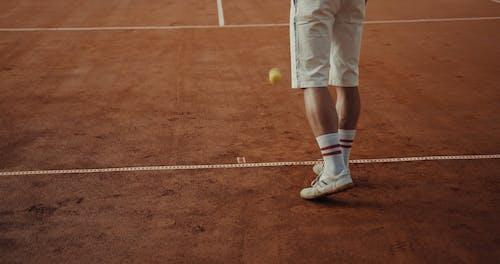 Young Men Playing Tennis