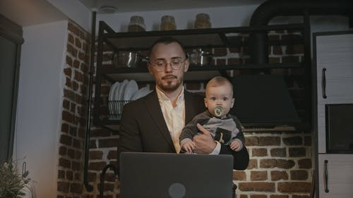 A Man In a Video Call while Carrying HIs Baby