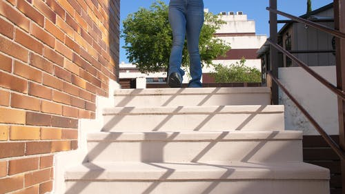 Person Going Down the Stairs