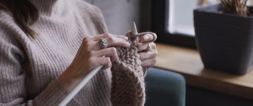 A Person Knitting