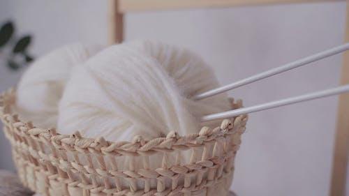 Balls of White Yarn in Jute Basket