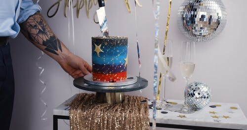 A Man Cutting the Cake