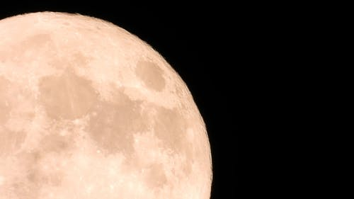 Extreme Close Up Shot of the Moon Passing Through