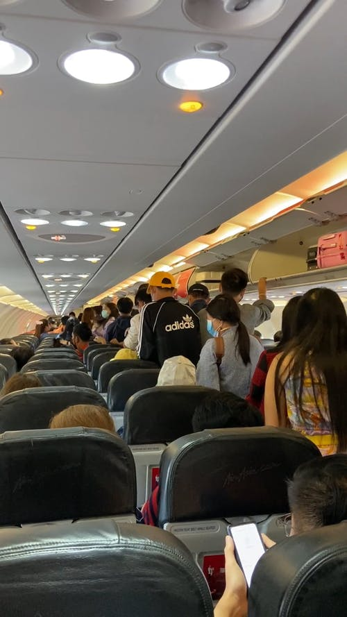 Passengers Ready to Leave an Airplane