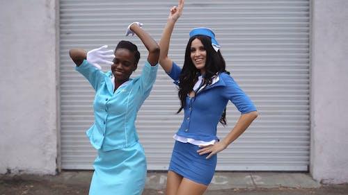 Two Flight Attendants Dancing Happily