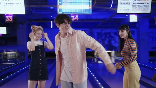 Male Teenager Celebrating His Victory in a Bowling Match with the Other Teenagers
