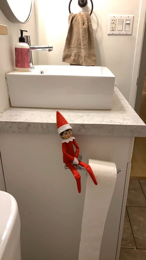 Elf on the Shelf Rolls Toilet Paper Down