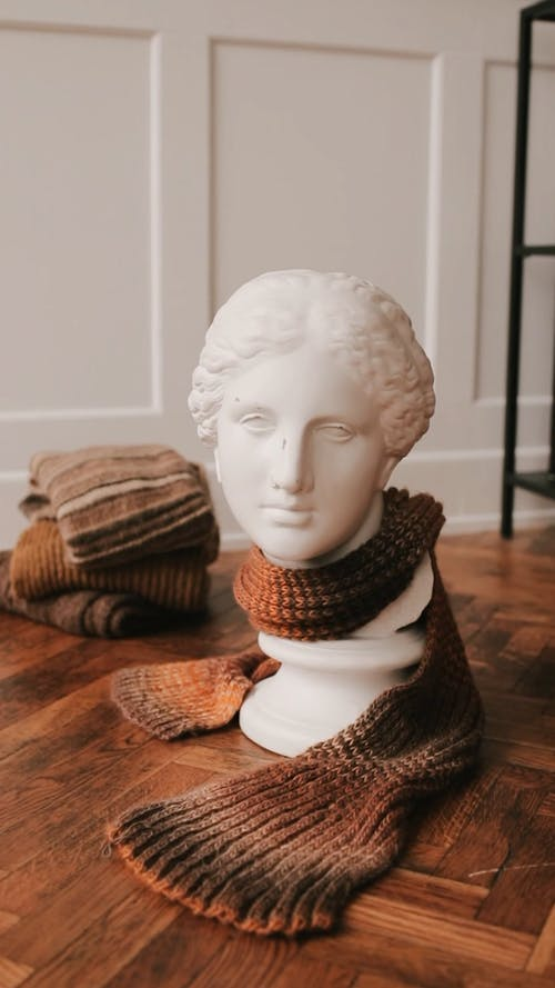 Vertical Video of a Statue Bust with a Scarf