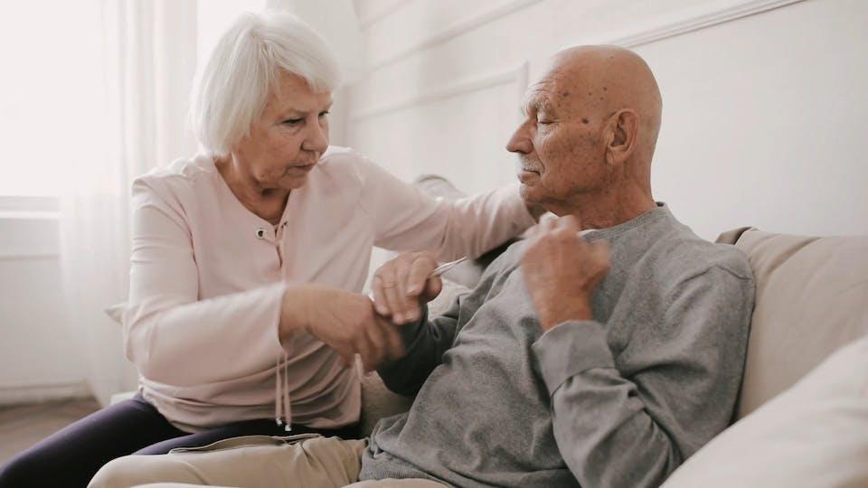Elderly Couple Using Temperature