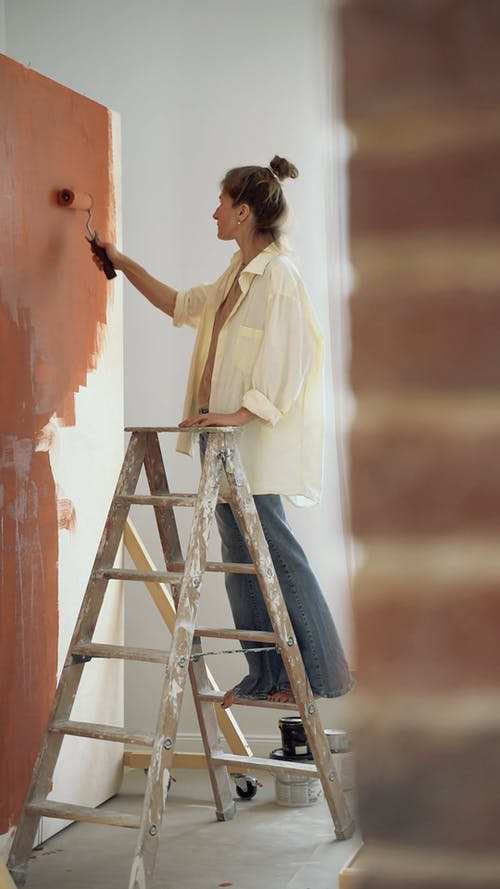 Woman Paiting a Wall