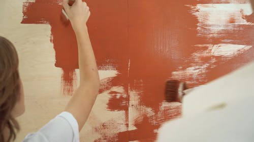 A Mom and Son Duo Painting their Walls