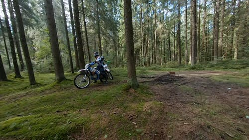 Aerial Footage of Two Motocyclists in the Forest