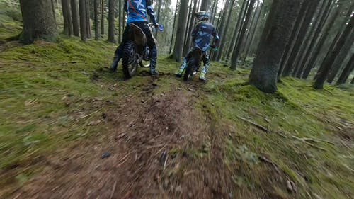 Aerial Footage of a Motorcyclist in the Forest