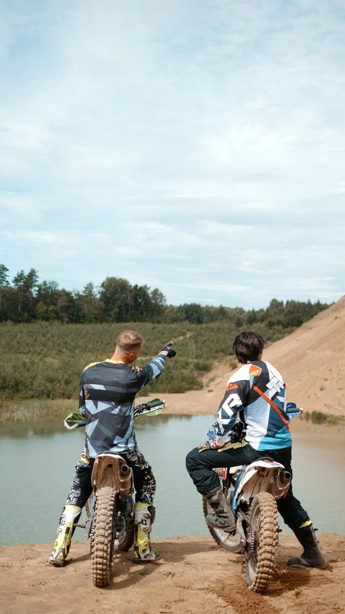 Two Motorcyclists Talking in the Outdoors