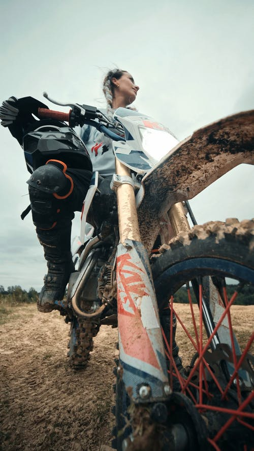 A Woman Riding a Dirt Bike