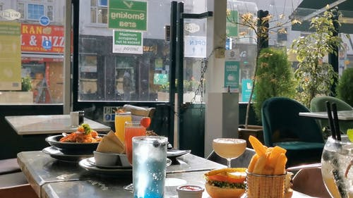 Foods and Drinks on a Restaurant Table
