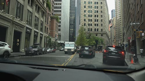 View of City Traffic from a Car Windshield
