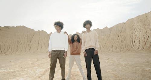 Three Models Posing in the Desert