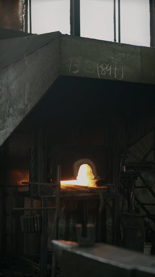 A Blacksmith Working over Iron