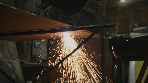 Crop Person Working on Metal With Plasma Cutter