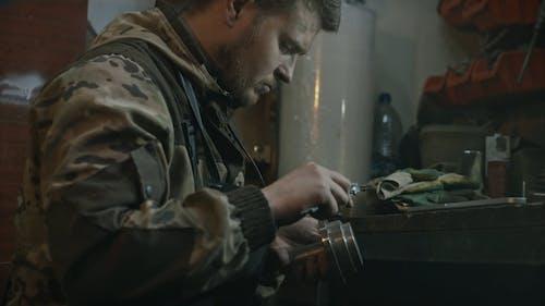 Young Man Measuring Metal Piece